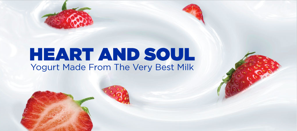 Strawberries in yogurt with text reading: Heart and Soul: Yogurt Made From the Very Best Milk